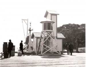 Immigration Station bell & light located at the end of the pier.