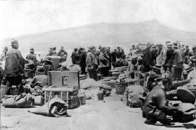 Passengers waiting at the Quarantine Station for disinfection with the Tiburon peninsula in the background.