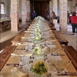 Inside the Quartermaster's Warehouse were long tables beautifully set with tan and white table cloths and white flowers.  Marcine knew what kind they were, but you know me and plant names.  Anyway, the place looked terrific.  In the back, right corner is where they had all the wine set up, and there was lots of it.
